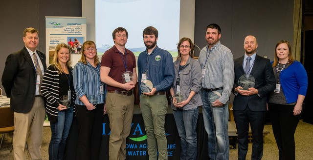 Photo: Sean McMahon, IAWA Executive Director, far left, and Jamie Benning, Water Quality Program Manager, Iowa State University Extension and Outreach, far right, with the 2018 IAWA Iowa Watershed Awards honorees. They include, left to right, Circle of Excellence honorees, Amanda Brown, Mindy Sieck, Colton Meyer, Shane Wulf, Velvet Buckingham, and Brian DeMoss, and 2018 Watershed Coordinator of the Year Lee Gravel. (Photo by Joseph L. Murphy, Iowa Soybean Association)