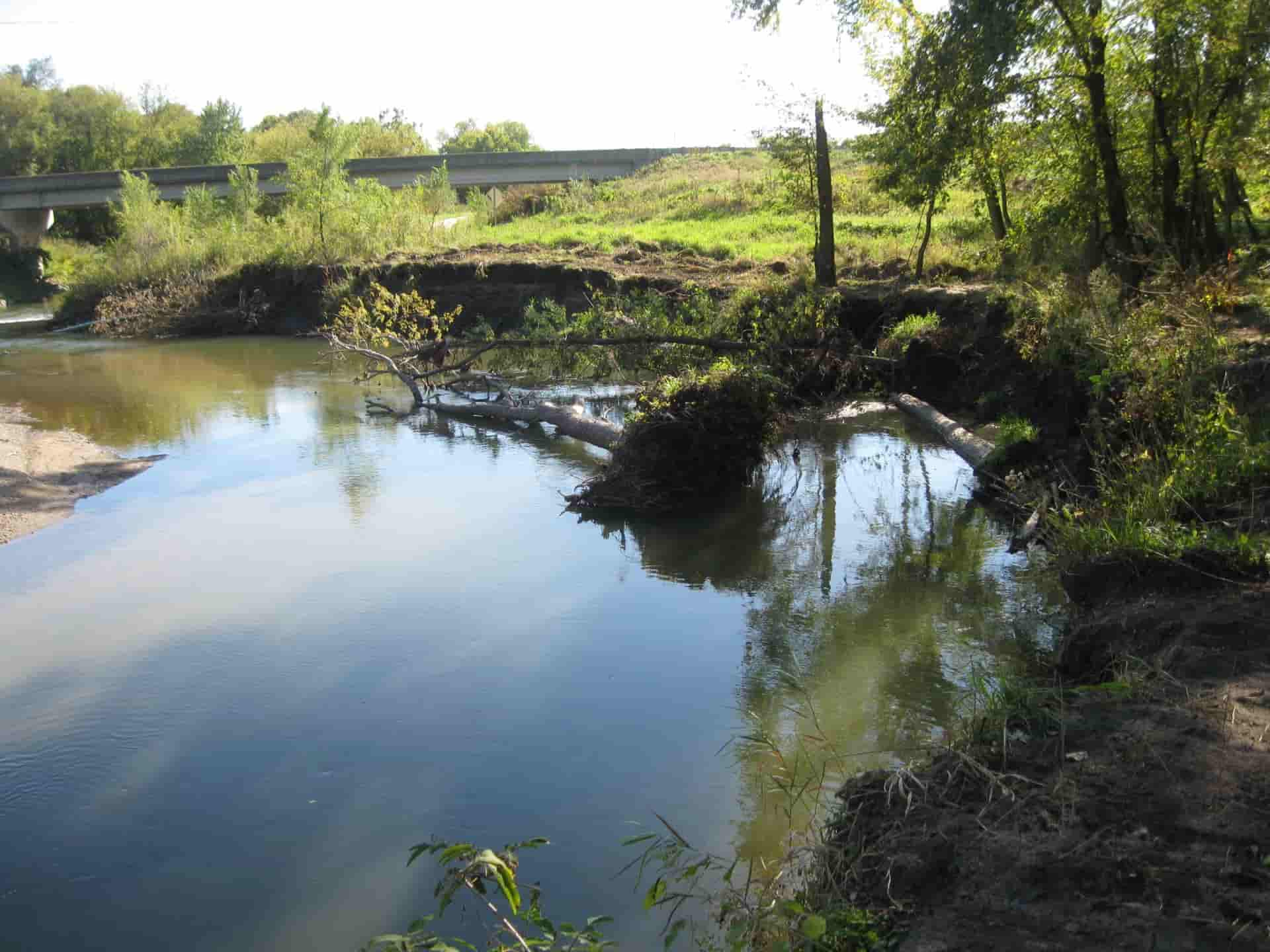 Same waterway but in the spring time with broken trees mostly cleared