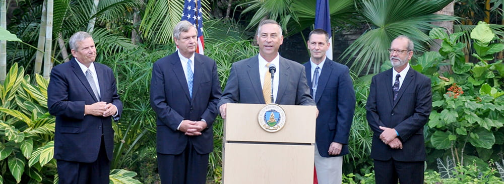 U.S. Secretary of Agriculture Tom Vilsack introduces Iowa's new State Conservationist, Kurt Simon at the Des Moines Botanical Center in October. Others congratulating Simon are Iowa Sec. of Ag., Bill Northey, Interim State Conservationist Rick Ellsmore and Deputy Director of the Iowa Department of Natural Resources, Bruce Trautman.