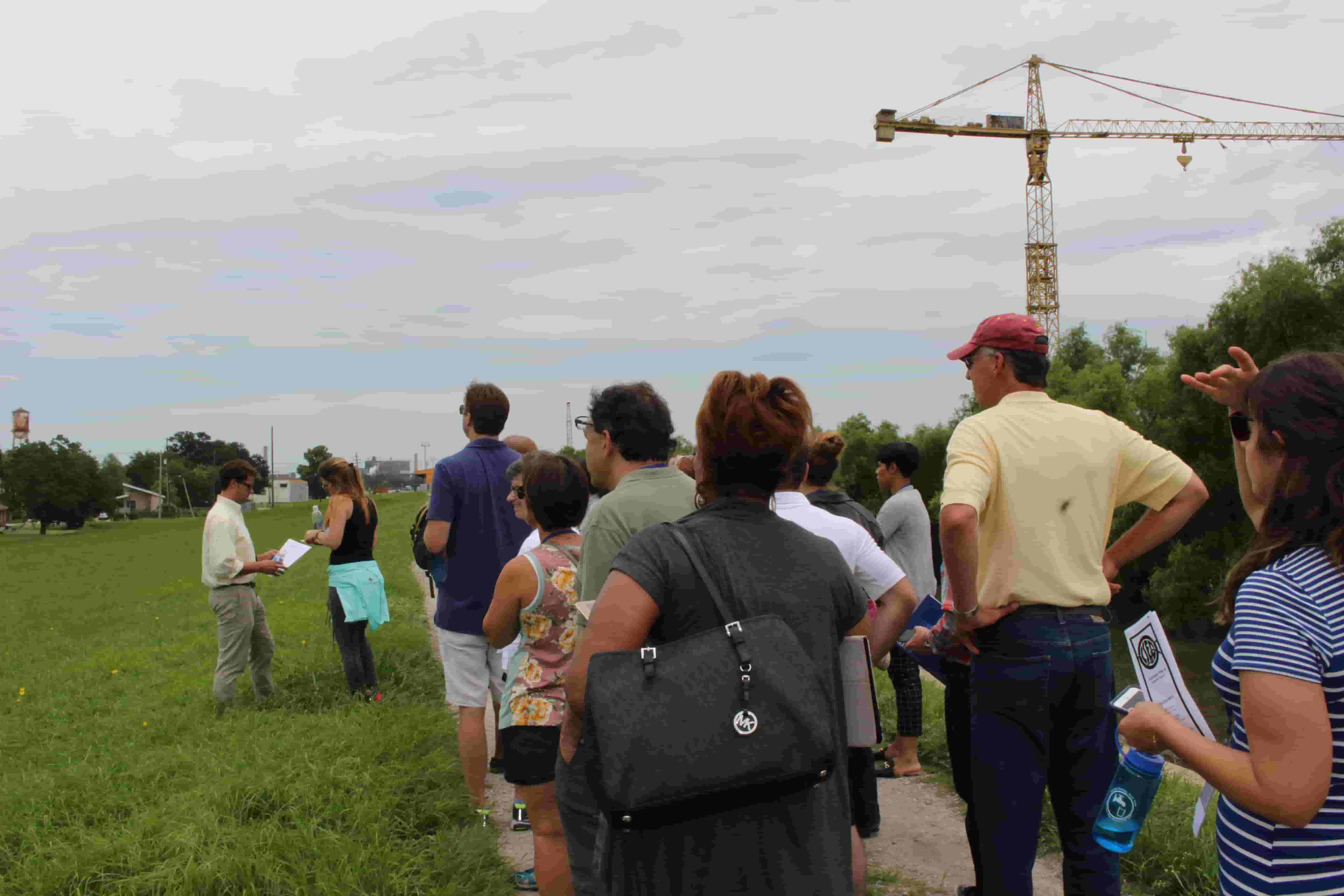 Delegates listen to speaker at excursion site, part of the One Water Summit agenda