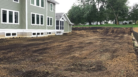Compost integrated with the back yard.